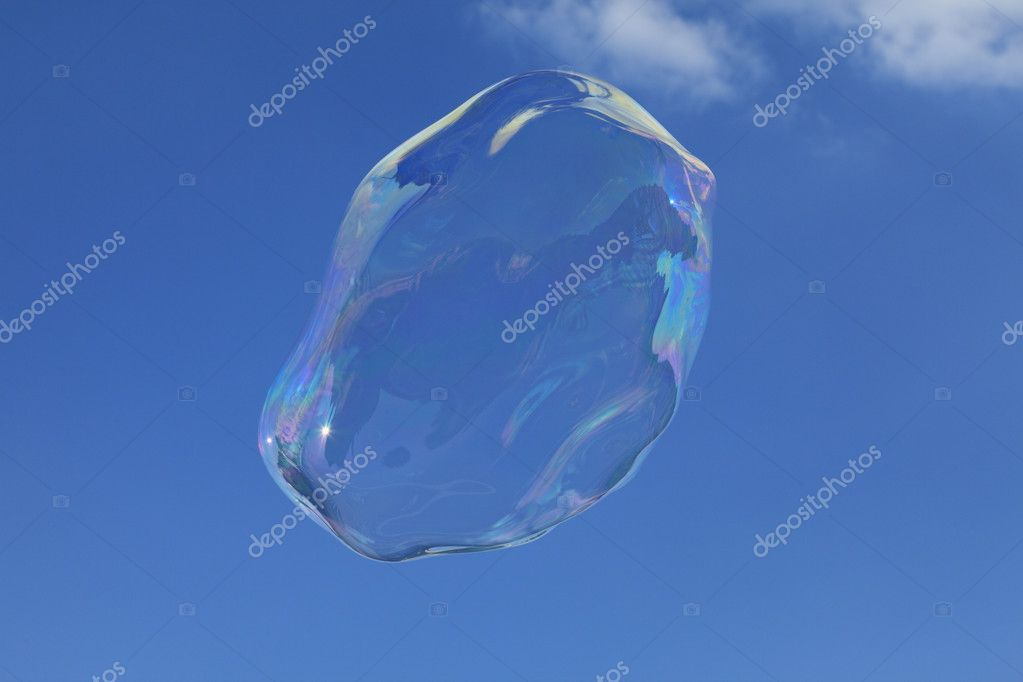 Image of a big bubble against a blue sky with few clouds. — Stock Photo #7091824