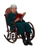 Old woman with a book — Stock Photo
