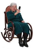 Senior woman taking photos with a phone — Stock Photo