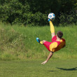Acrobatic soccer player — Stock Photo