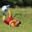 Acrobatic soccer player — Foto Stock
