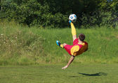 Acrobatic soccer player — Stock Photo