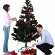 图库照片: Decorating the Christmas tree