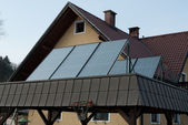 Solar cells in front of house — Stock Photo