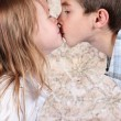 Boy and girl kissing — Stock Photo