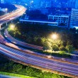 Road junction with blurred colorful lines at dawn - Stock Photo