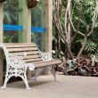 Chair on summer house wooden deck - Stock Photo