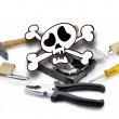 Foto de Stock  : Death'head above hard disk opened with tools