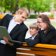 Stock Photo: Young business with laptop