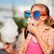Girl eating cotton candy — Stock Photo #6772675
