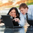 Young couple working on laptop — Stock Photo #6826520