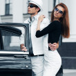 Young couple with a retro car — Stock Photo #6826599