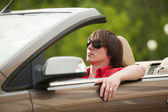 Young man driving a convertible car — Stock Photo