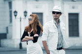 Young couple on the city street — Stock Photo
