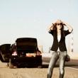 Young woman with a broken car — Stock Photo #6858431