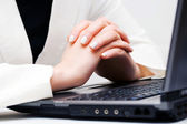 Female hands working on laptop — Stock Photo