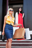 Two young women with shopping bags — Stok fotoğraf
