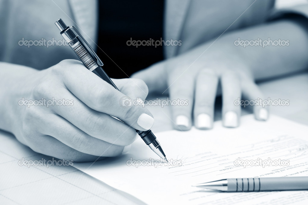 Female hand signing contract  Stock Photo #6858438