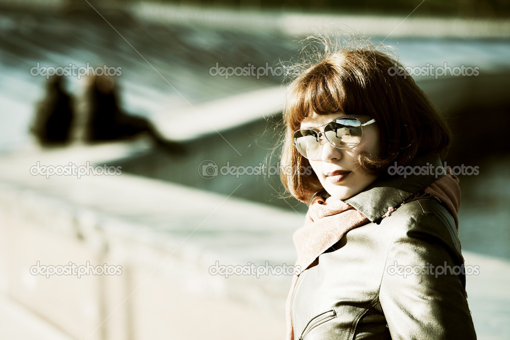 Thoughtful young woman on the city street.  Stock Photo #6858477