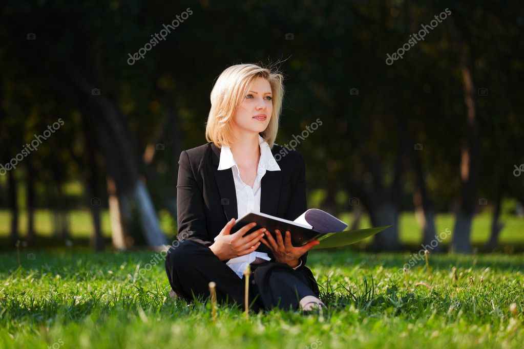Young businesswoman with a folder  — Stock Photo #6858525