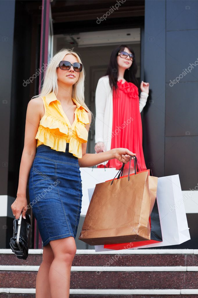 Two young women with shopping bags — Stock Photo #6858608