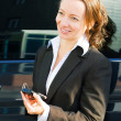 Stock Photo: Businesswoman with a cell phone