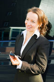 Businesswoman with a cell phone — Stock Photo