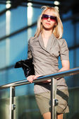Young businesswoman on the steps — Stock Photo