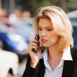 Young businesswoman calling on the mobile phone — Stock Photo