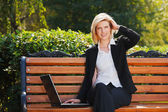 Happy businesswoman with laptop — Stock Photo