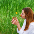 Young woman and wild flower - Stock Photo