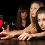 Young women in a night bar — Stock Photo