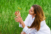 Young woman with a flower — Stockfoto