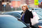 Young shopper on the car parking — Stock Photo