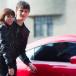 Stock Photo: Happy young couple with a car