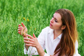 Woman and wild flower — Stock Photo