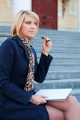 Young businesswoman with notebook — Stock Photo