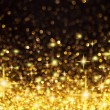 Golden Christmas Lights and Stars Background — Stock Photo #7297632