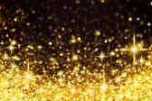 Golden Christmas Lights and Stars Background — Stock Photo
