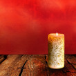 Royalty-Free Stock Photo: Christmas Candle on a Wooden Table
