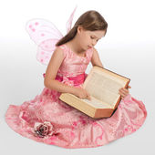 Little fairy magic book reads — Stock Photo