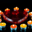 Royalty-Free Stock Photo: Heart , surrounded small candles.