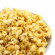 Bowl full of caramel popcorn isolated on white - Stock Photo