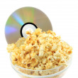 Bowl full of caramel popcorn with DVD disk . - Stock Photo