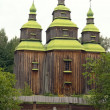 Old  wooden church in the Ukrainian Village. - Stock Photo