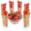 Glass with fresh strawberries  on white. Isolated - Stock Photo