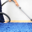 Royalty-Free Stock Photo: Vacuum cleaner in action-men cleaner a carpet.