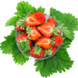 A heap of strawberries on green foliage. Isolated - Stock Photo