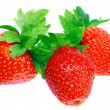 Three fresh strawberries. Isolated — Stock Photo