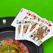 Casino - playing cards on green broadcloth. — Stock Photo